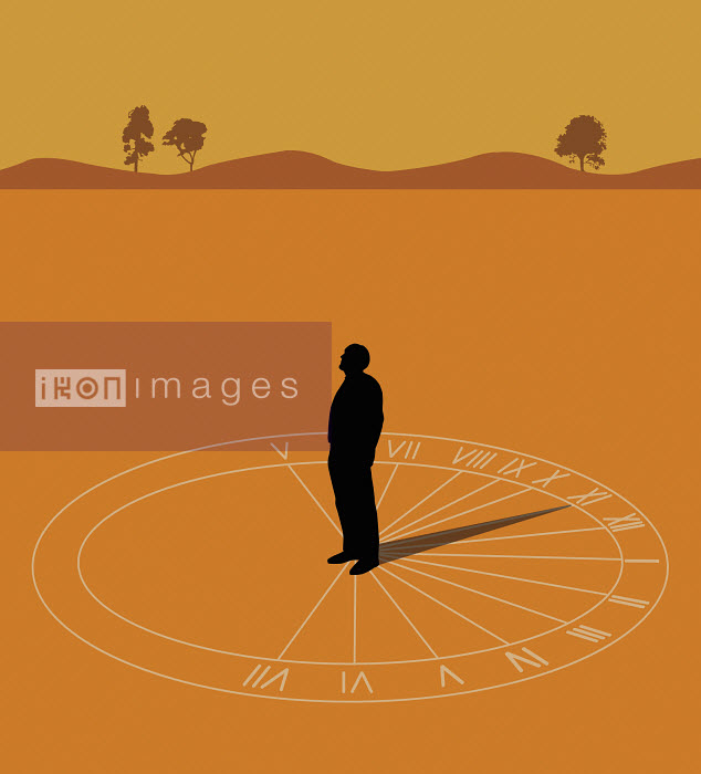 Man standing on sundial showing the eleventh hour - Man standing on sundial showing the eleventh hour - Nick Lowndes
