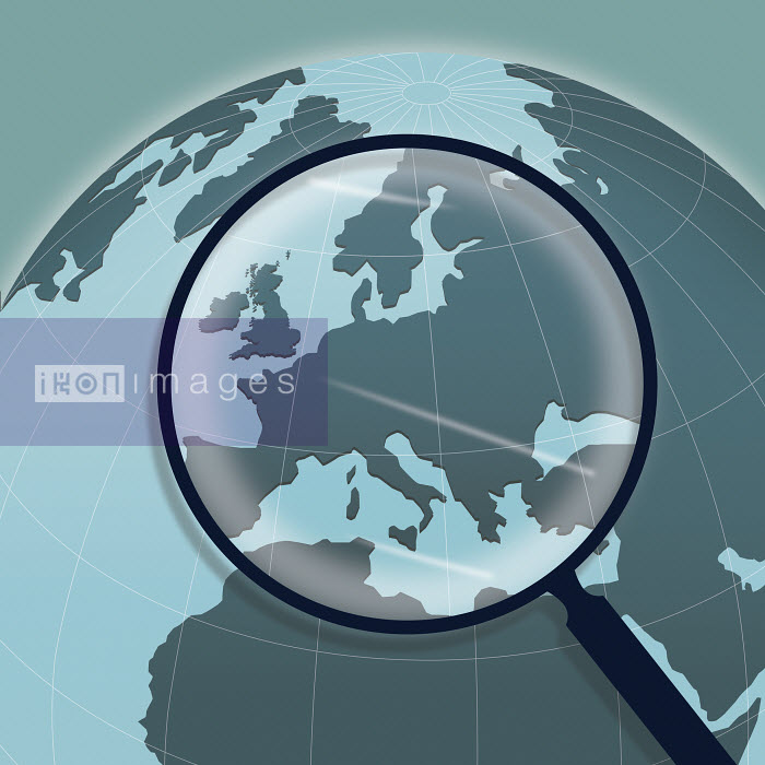 Magnifying glass above Europe on globe - Magnifying glass above Europe on globe - Nick Lowndes