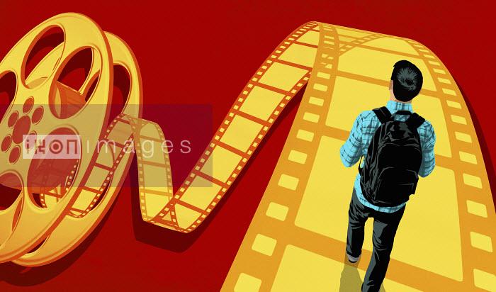 Teenager walking on film strip - Teenager walking on film strip - Taylor Callery