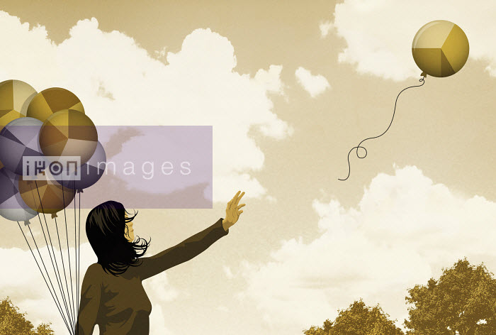 Woman releasing balloon with pie chart - Woman releasing balloon with pie chart - Taylor Callery