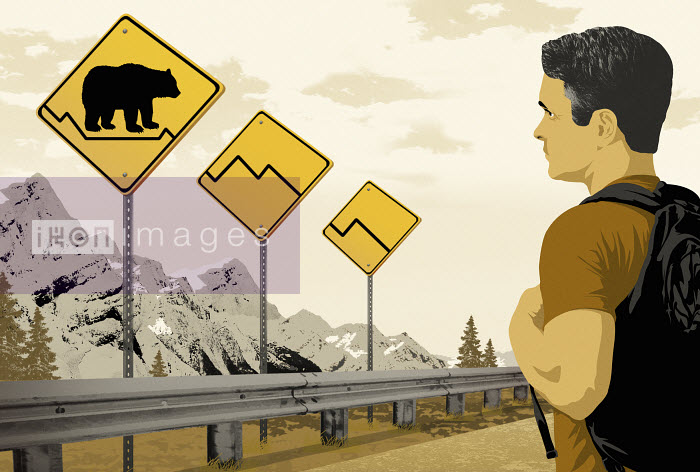 Man looking at road signs with bear and downside trend - Man looking at road signs with bear and downside trend - Taylor Callery