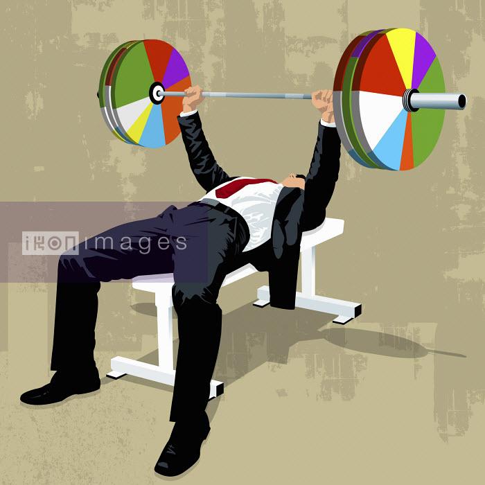 Businessman lifting pie chart barbell - Businessman lifting pie chart barbell - Taylor Callery
