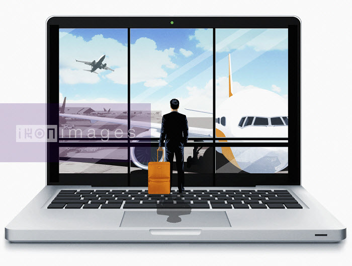 Businessman on laptop keyboard looking at starting plane - Businessman on laptop keyboard looking at starting plane - Taylor Callery