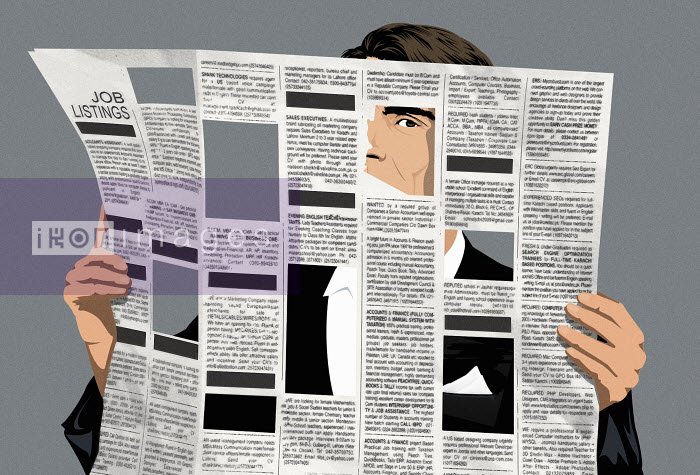 Man holding newspaper with missing job ads - Man holding newspaper with missing job ads - Taylor Callery