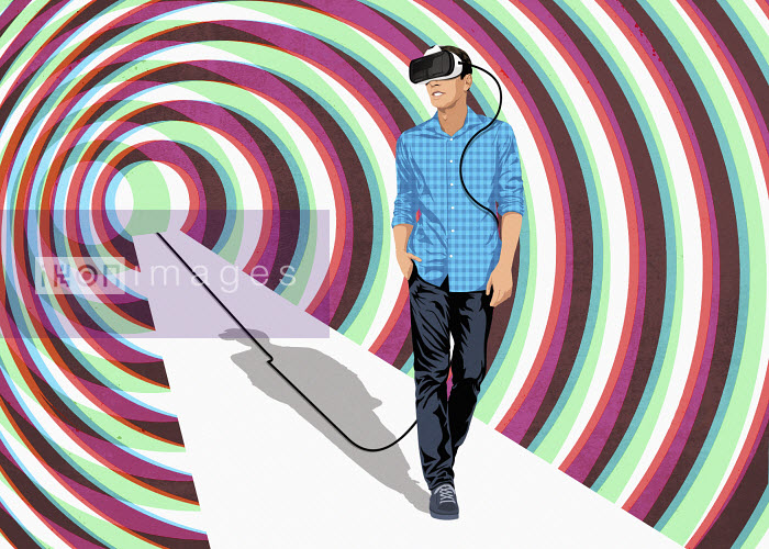 Young man walking with virtual reality glasses - Young man walking with virtual reality glasses - Taylor Callery