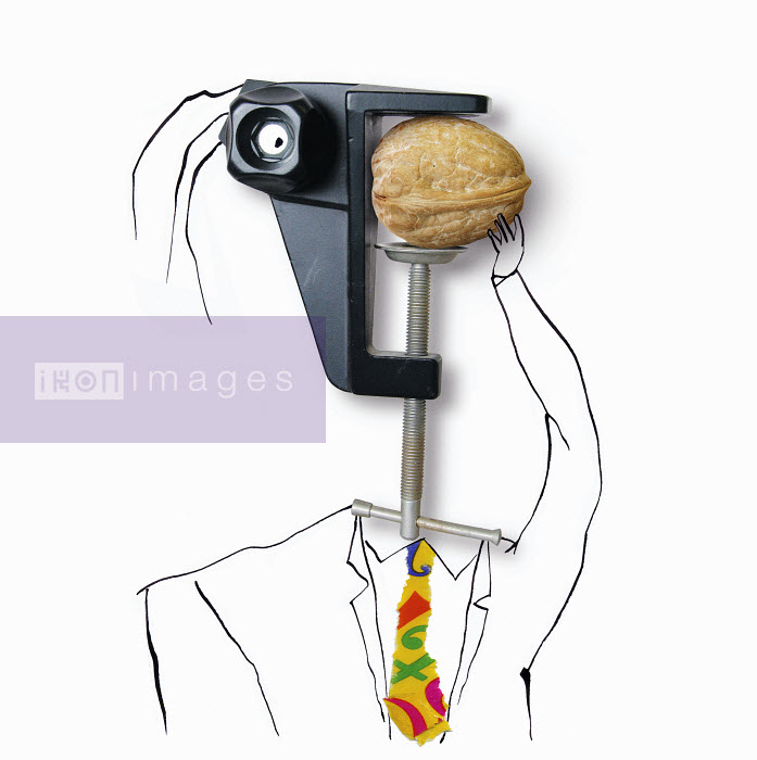 Man with clamp head trying to crack walnut - Man with clamp head trying to crack walnut - Roger Chouinard