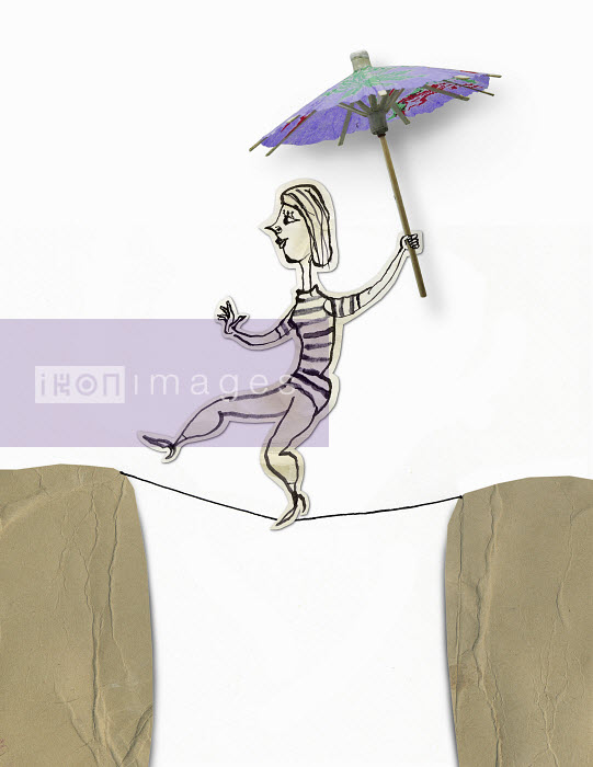 Woman holding cocktail umbrella balancing on tightrope - Woman holding cocktail umbrella balancing on tightrope - Roger Chouinard