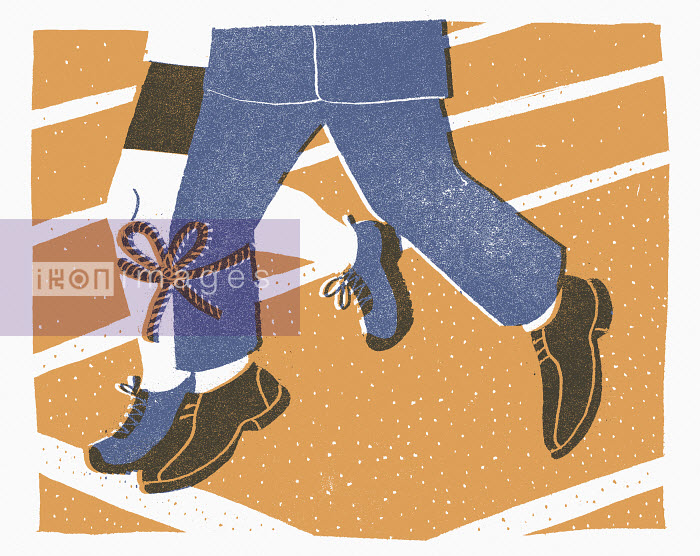 Legs of two men tied together on running track - Legs of two men tied together on running track - Sophie Casson