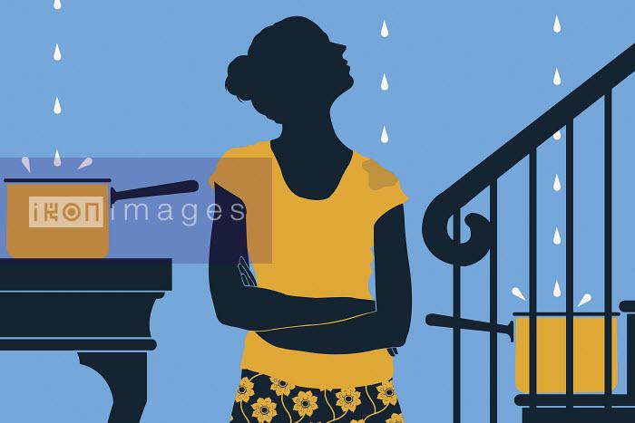 Woman looking at leaking roof - Woman looking at leaking roof - Neil Webb