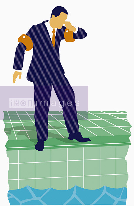Businessman standing by swimming pool - Businessman standing by swimming pool - Neil Webb