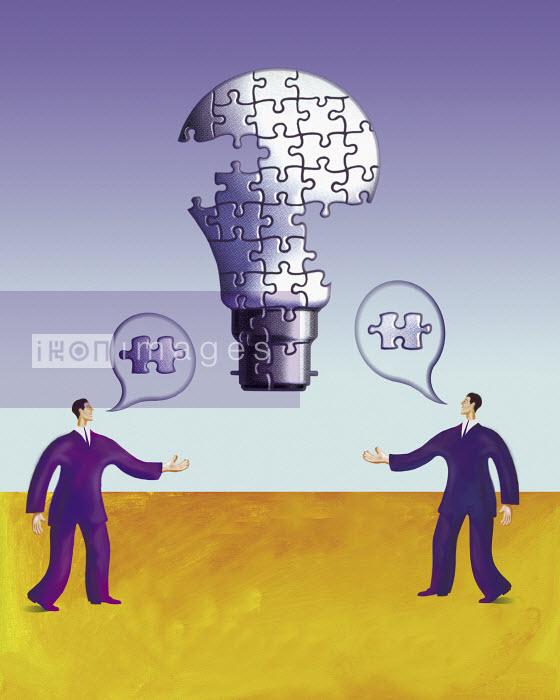 Two businessmen talking building up lightbulb made of puzzle pieces - Two businessmen talking building up lightbulb made of puzzle pieces - Gary Bates