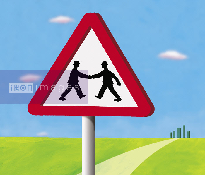 Two businessmen shaking hands inside give way sign - Two businessmen shaking hands inside give way sign - Gary Bates