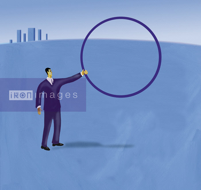 Businessman holding up hoop - Businessman holding up hoop - Gary Bates