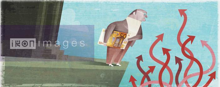 Businessman holding money near tangle of arrows - Businessman holding money near tangle of arrows - Pablo Blasberg