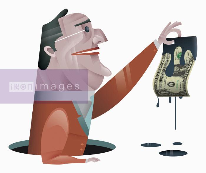 Businessman holding dollar bill dripping oil - Businessman holding dollar bill dripping oil - Pablo Blasberg
