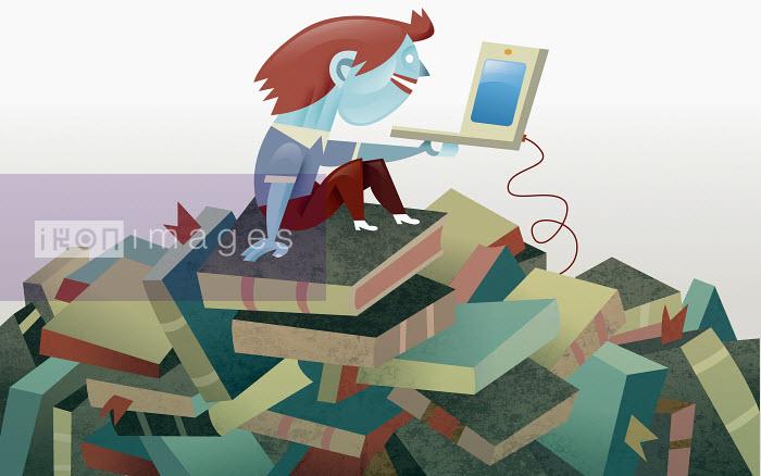 Pablo Blasberg - Boy with laptop sitting on pile of books