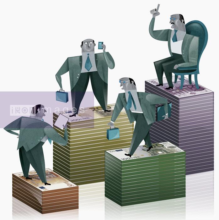 Businessman standing on stacks of money - Businessman standing on stacks of money - Pablo Blasberg