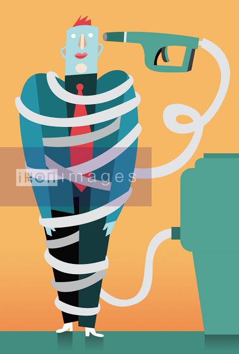 Businessman wrapped in fuel pump hose - Businessman wrapped in fuel pump hose - Pablo Blasberg