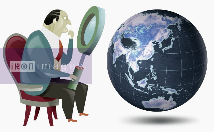 Businessman looking at globe with magnifying glass - Businessman looking at globe with magnifying glass - Pablo Blasberg