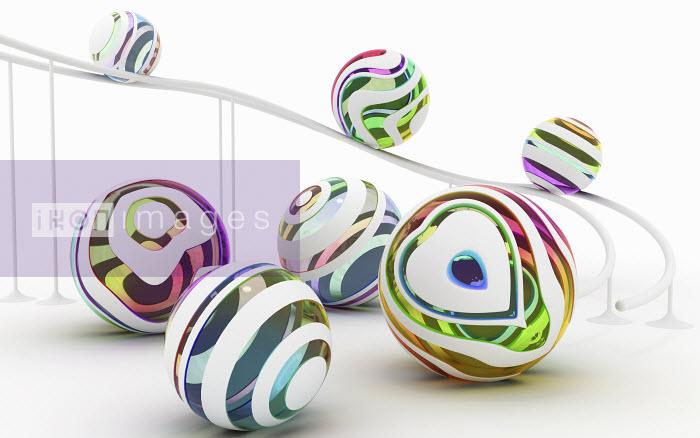 Multi-colored balls rolling down ramp - Multi-colored balls rolling down ramp - K3
