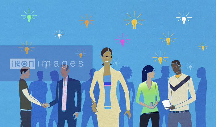 Group of people working together and sharing ideas under light bulbs - Group of people working together and sharing ideas under light bulbs - Nick Purser