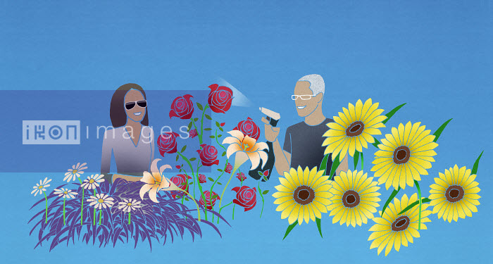 Woman and man caring for flowers - Woman and man caring for flowers - Nick Purser