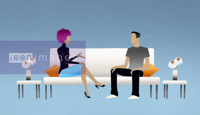 Man and woman on couch talking - Man and woman on couch talking - Nick Purser