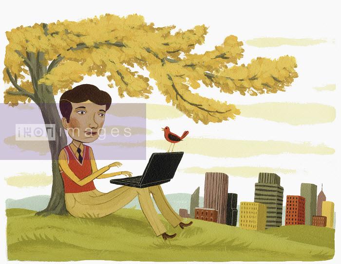 Businessman using laptop under tree - Businessman using laptop under tree - Bjorn Lie