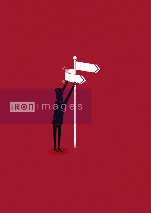 Man changing the direction at a signpost - Man changing the direction at a signpost - Ben Sanders