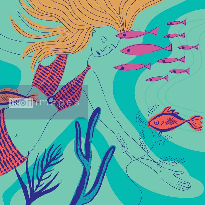 Trina Dalziel - Woman swimming with fish underwater