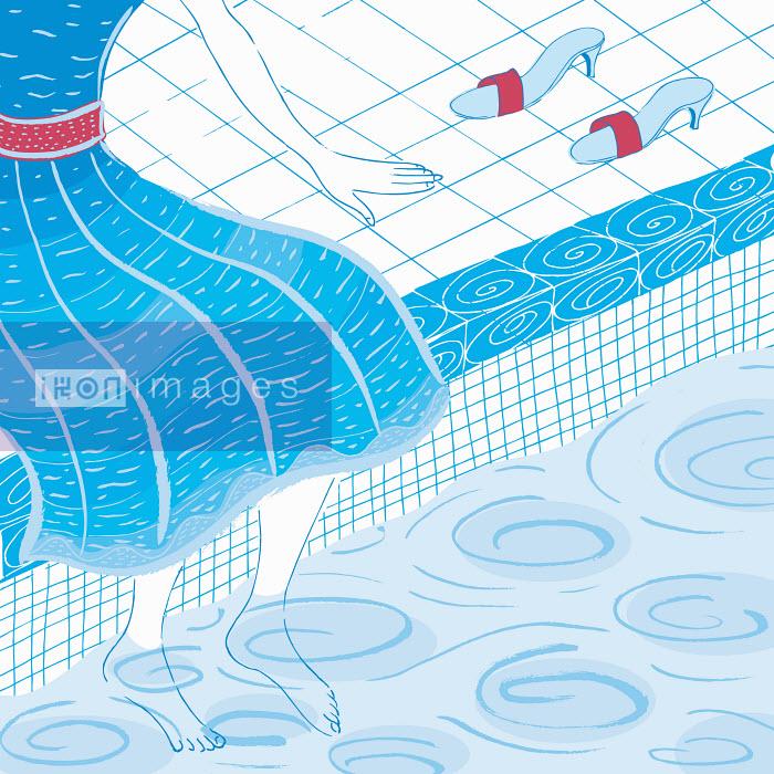 Woman sitting with feet in swimming pool Trina Dalziel