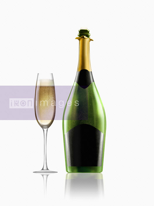 Glass of champagne next to champagne bottle with black label Nick Purser