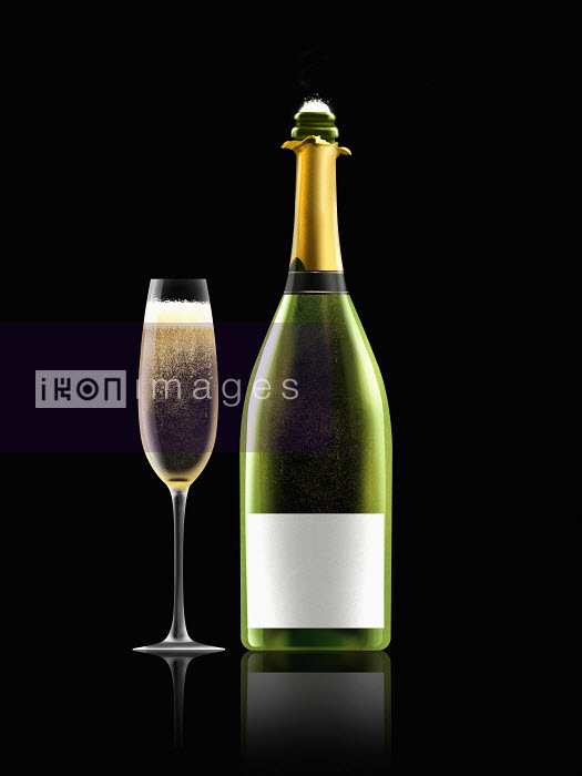 Glass of champagne next to champagne bottle with white label - Nick Purser