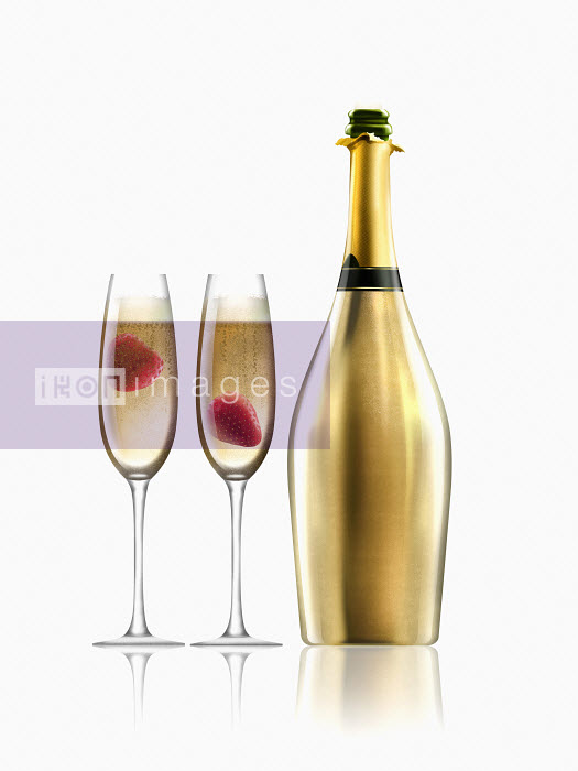 Nick Purser - Two glasses of champagne with strawberries next to gold champagne bottle