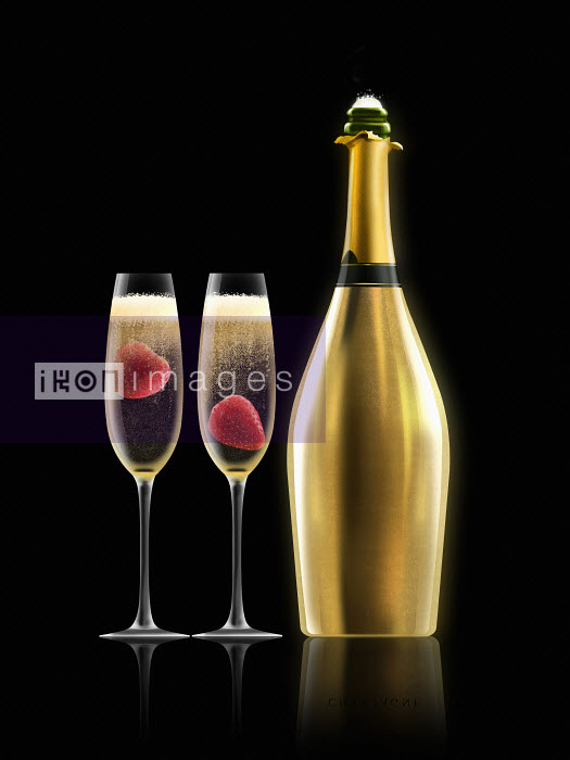 Two glasses of champagne with strawberries next to gold champagne bottle - Nick Purser