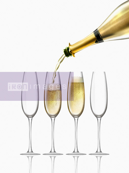 Gold champagne bottle filling four champagne flutes Nick Purser