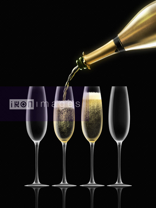 Nick Purser - Gold champagne bottle filling four champagne flutes