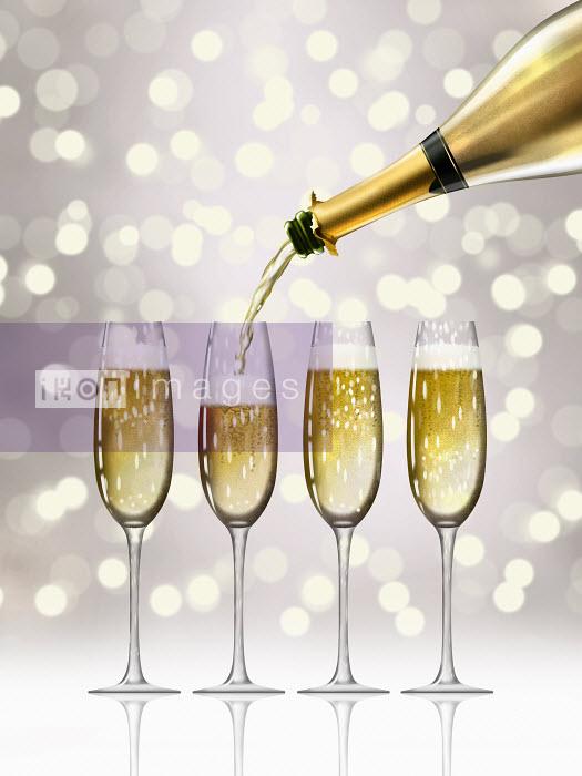 Nick Purser - Gold champagne bottle filling sparkling champagne flutes