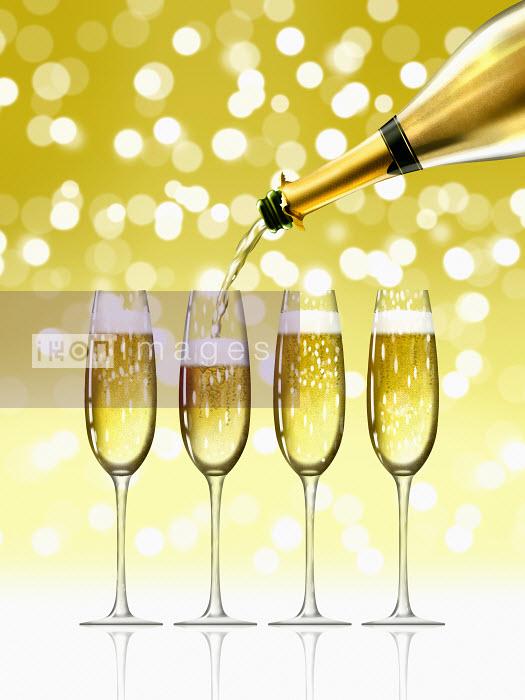 Gold champagne bottle filling sparkling champagne flutes Nick Purser