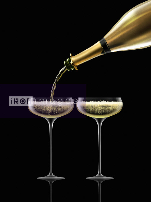 Nick Purser - Gold champagne bottle filling two champagne coupe glasses
