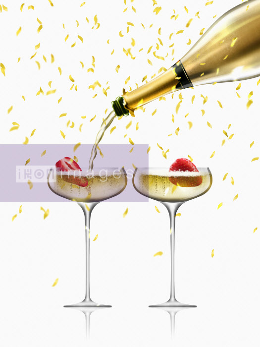 Confetti falling on gold champagne bottle filling two champagne coupes Nick Purser