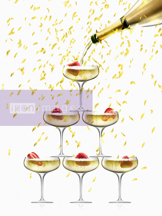 Nick Purser - Confetti falling on coupe glasses in champagne pyramid