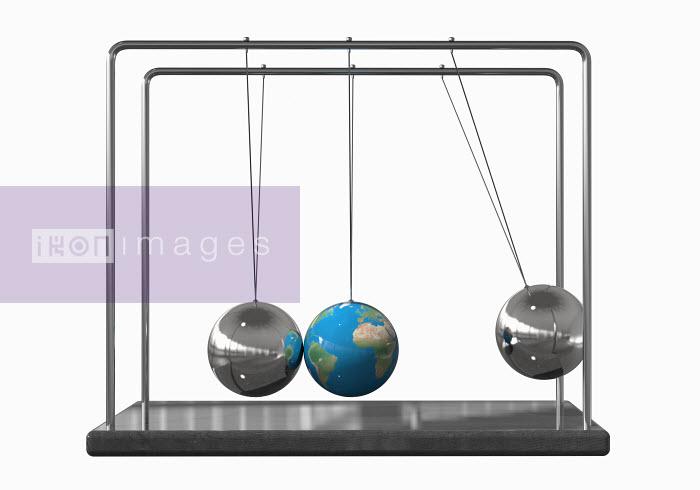 Claus Lunau - Globe as ball on Newton's Cradle