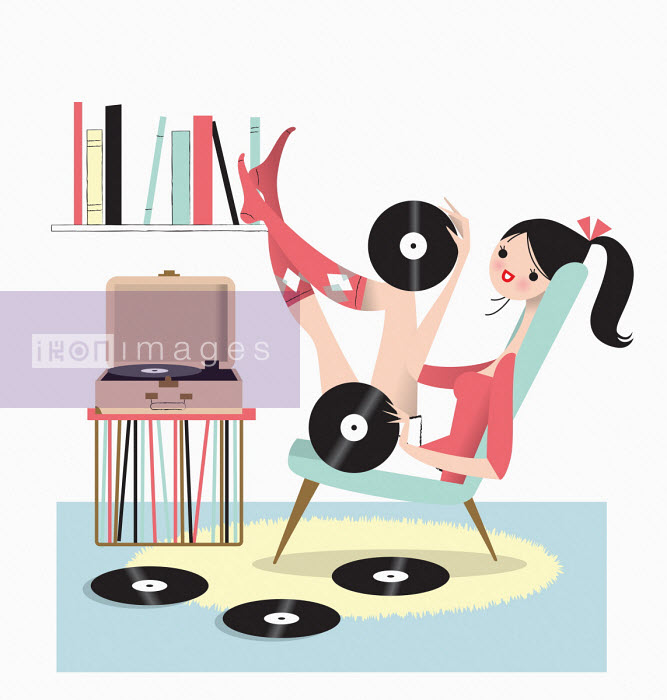 Woman with feet up listening to record player Nila Aye