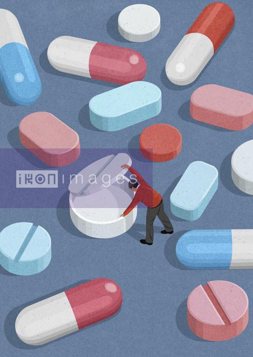 Man lifting lid on empty placebo pill John Holcroft