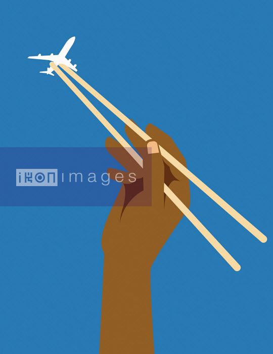 Hand catching aeroplane in chopsticks Josh McKible