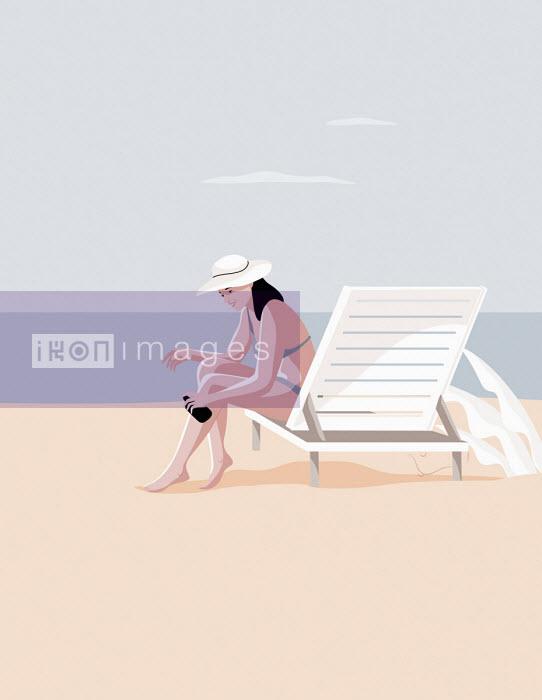Woman applying sun lotion on beach - Camelia Dobrin