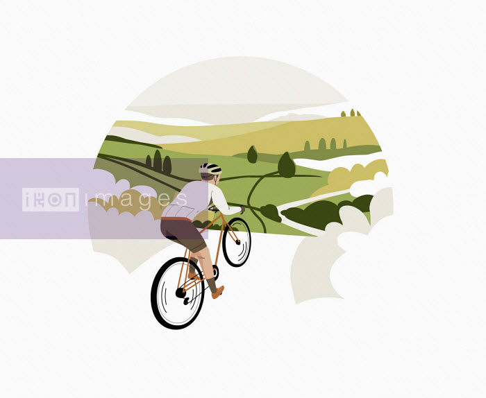 Cyclist riding bike through countryside - Camelia Dobrin