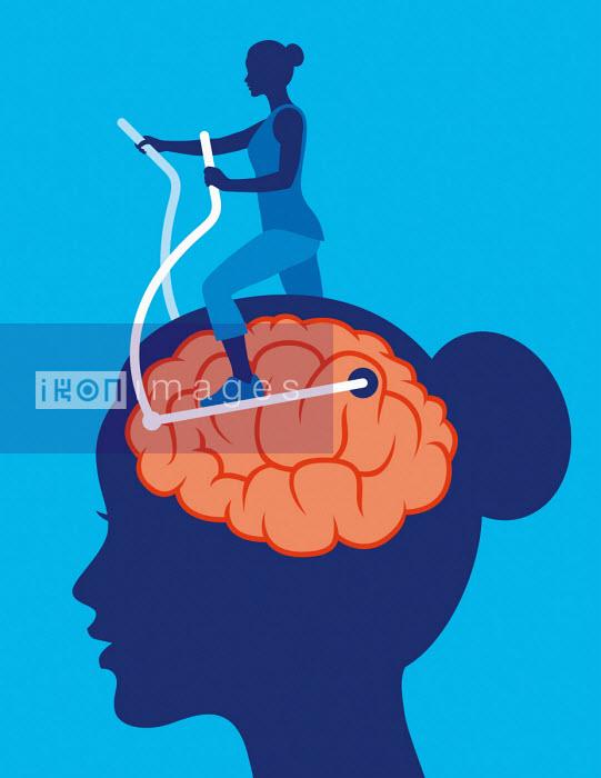 Woman exercising brain using cross trainer - Patrick George
