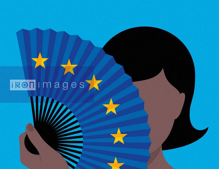 Woman hiding identity behind European Union flag fan - Patrick George